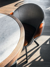 Leather Chair At Marble Table