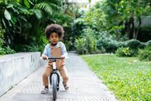 Cute Boy Riding A Bike