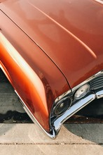 Classic Red Muscle Car Front Headlight
