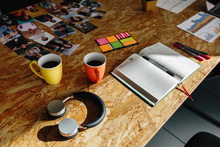Modern Headphones And Coffee On A Wooden Office Table