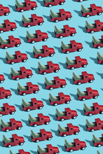 Mosaic Of Red Toy Cars With Christmas Trees