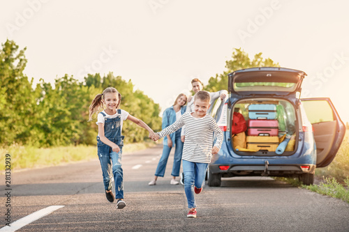 Fotografia, Obraz  Happy children and their parents near car outdoors
