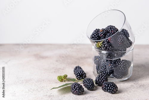 Glass bowls with tasty blackberries on grey table Tapéta, Fotótapéta