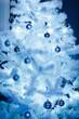 Christmas balls on a white fluffy Christmas tree