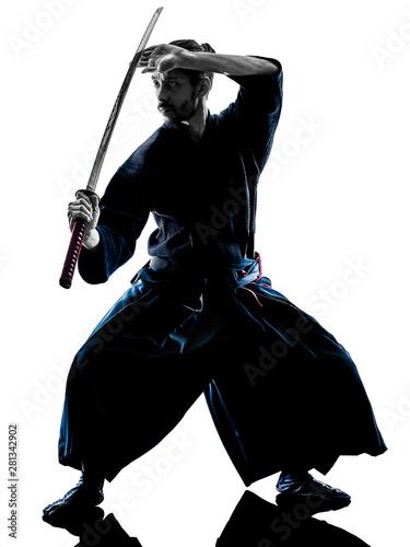 one caucasian man practicing laido Katori Shinto ryu isolated shadow silhouette Canvas Print