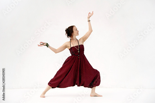 Photo  Dancing yoga woman. Photographed on a white background.