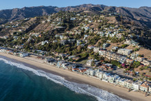 Aerial View Of Malibu Beaches, Homes And Hillsides North Of Santa Monica On Pacific Coast Highway In Los Angeles County, California.