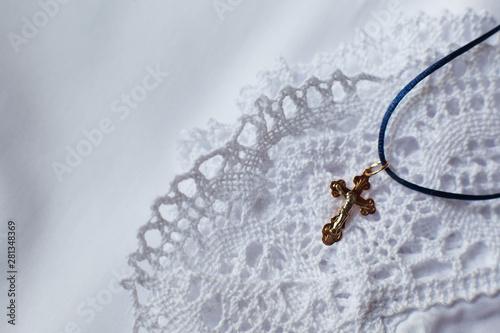 Photographie Christening accessories: little golden cross on christening blanket