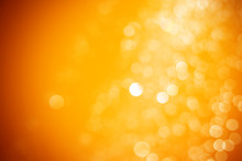 Abstract Orange And Yellow Light Bokeh Background. Bokeh Backgrounds Color Gold.