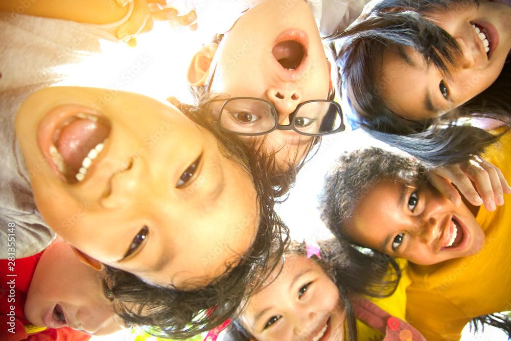 Fototapeta closeup Multi-ethnic group of schoolchildren face