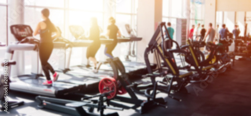 Blurred photo of a gym with people on treadmills - 281362702