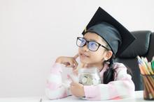 Little Asian Girl Wearing Grad...
