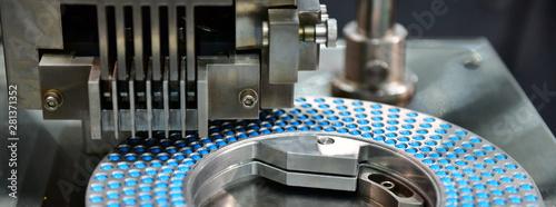 Fotografia  Blue capsule medicine pill production line, Industrial pharmaceutical concept