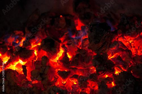 Poster de jardin Texture de bois de chauffage Nature fire flames on black background. Fire burning firewood burning fire flame texture in the fireplace charcoal. Concepts: fire, BBQ, barbeque, still life
