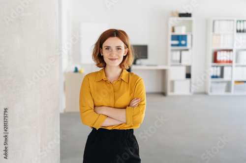 Happy relaxed confident young businesswoman