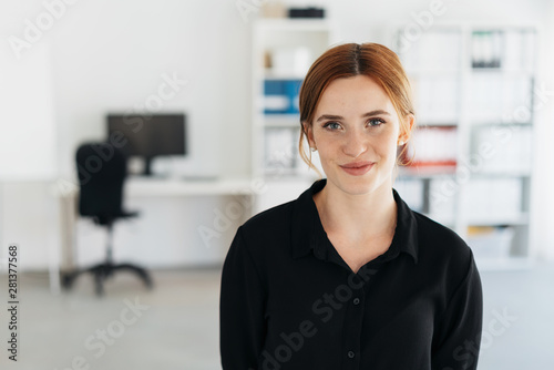 Young businesswoman with a quiet friendly smile