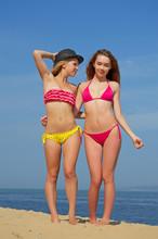 Girls In Thongs On The Beach.