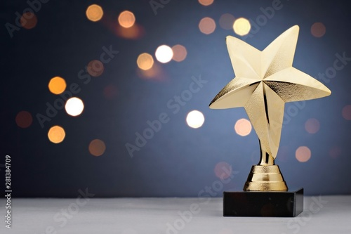 Photo Gold star trophy for a winner or champion