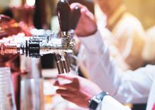 Bartender Pouring Draft Beer I...