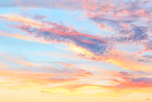 Heavenly Abstract Summer Gentle Background. Beautiful Picturesque Bright Majestic Dramatic Evening Morning Sky At Sunset Or Dawn In Orange And Blue In Pastel Colors. The Sun Rises On A Warm Day