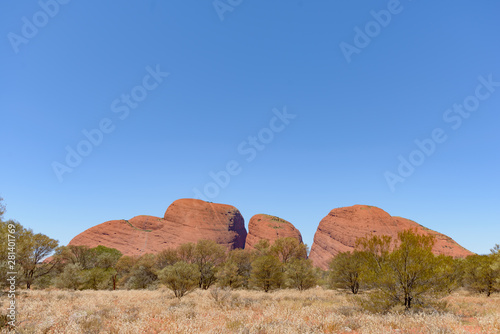 Photo Stands Australia Kata Tjuṯa, also known as the Olgas, is a group of 36 red-rock domes of the Kata Tjuta in Tjuta National Park, Northern Territory, central Australia.