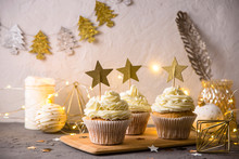 Christmas Stylish Dessert Cupcakes With Cream And Golden Stars
