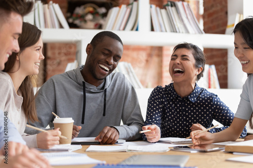 Obraz Smiling multiracial young people have fun studying together - fototapety do salonu