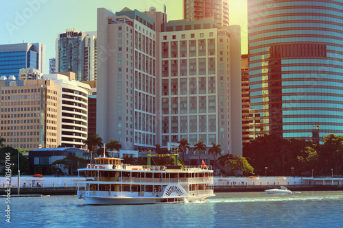 Skyscrapers at the Brisbane river with with paddle wheel boat in front, Australia