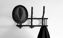 Old Coat Hanger With Hat And Coat In Black And White
