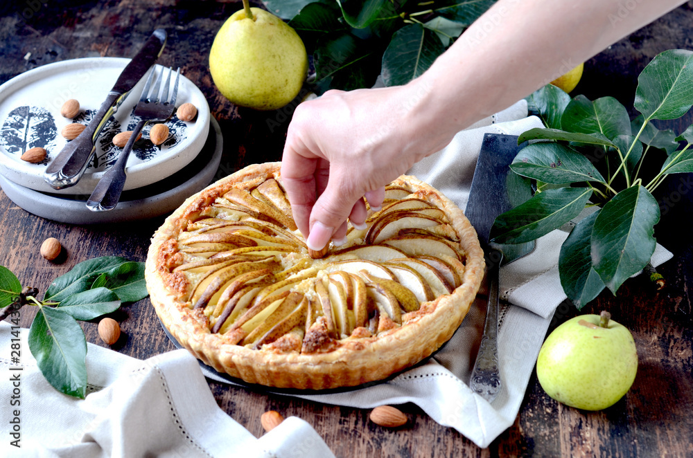 Fototapety, obrazy: Pears tart with frangipani on a dark wooden table