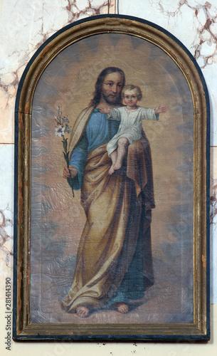 Fotografering Saint Joseph holding child Jesus, altarpiece in the church of the Saint Maximili