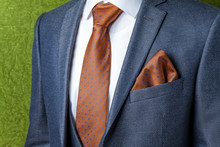 Stylish Gray Men's Suit And White Shirt With A Brown Tie. Male Style. Close-up.