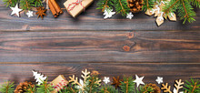 Christmas Background With Fir Tree And Gift Box On Wooden Table. Top View Banner With Copy Space For Your Design