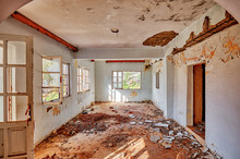 Interior Of An Old Desolated House With White Cracked Walls And Broken Windows