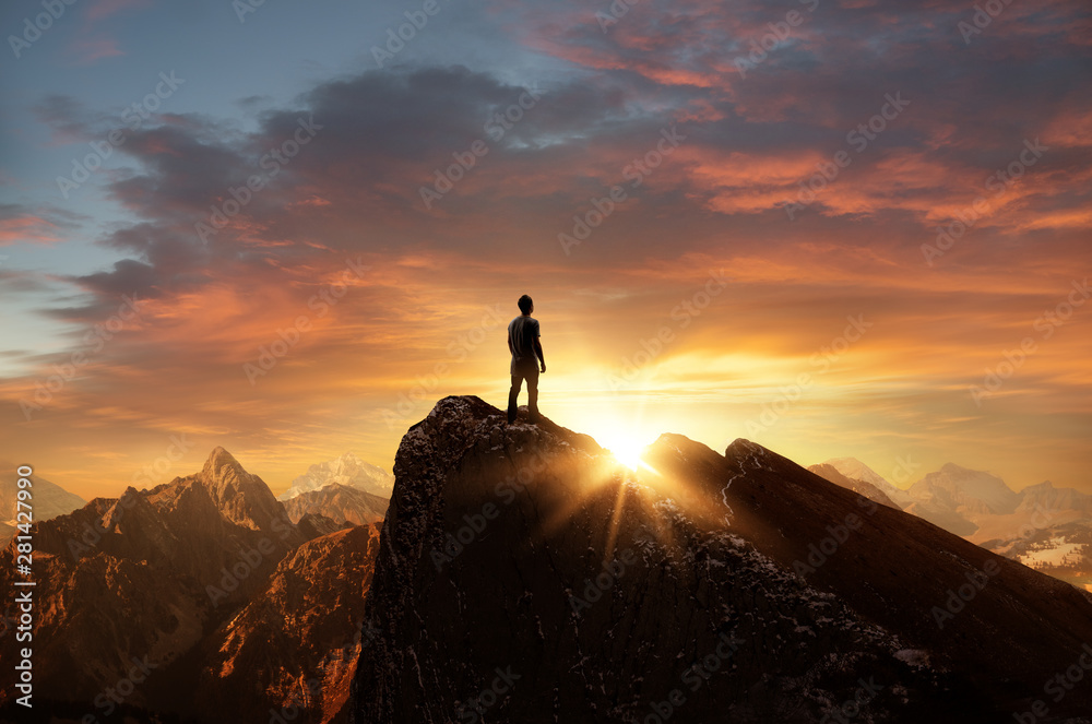Fototapety, obrazy: A man standing on top of a mountain as the sun sets. Goals and achievements concept photo composite.
