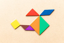 Color Tangram Puzzle In Copter Or Helicopter Shape On Wood Background
