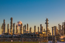 Oil Refinery Stacks Against A ...