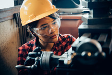 Asian Beuatiful Woman Working With Machine In The Factory Engineer And Working Woman Concept Or Woman Day