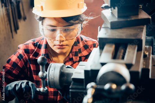 Fototapeta  Asian beuatiful woman working with machine in the factory engineer and working w