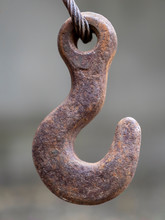 A Rusty Old Hook Hangs On A St...