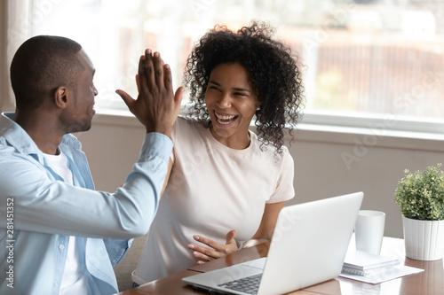 Stampa su Tela  Happy african couple celebration victory feels overjoyed