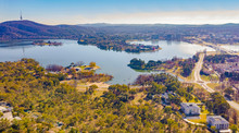 Panorama View Of Canberra, The Capital City Of Australia, Looking North Over Lake Burley Griffin With Black Mountain And Telstra Tower To The Left And Commonwealth Bridge At Right