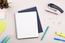 Planner On The Grey Wooden Working Table. Blank White Paper On Working Desk