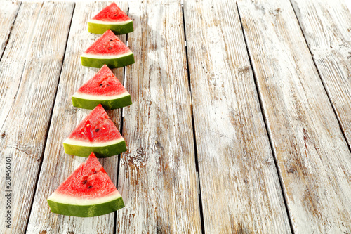 Sliced watermelon on a wooden table background
