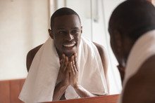 African Man Looking In Mirror ...