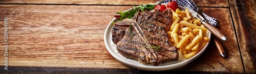 Recess Fitting Steakhouse Panorama banner with barbecued T-bone steak