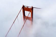 San Francisco Golden Gate Bridge Covered In Fog / Clouds