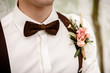 canvas print picture - groom with a flower