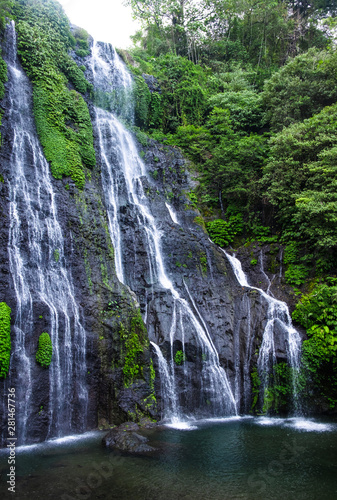 Banyumala Twin Waterfalls. Jungle waterfall cascade in tropical rainforest with rock and turquoise blue pond. Bali, Indonesia.  Wall mural