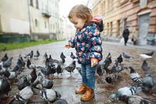 Funny Baby Girl Standing Among...